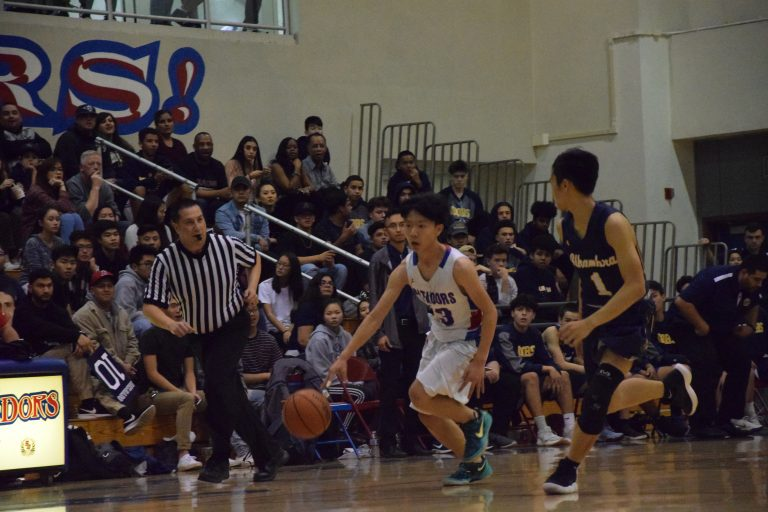 Boys varsity basketball dominates league with first home win