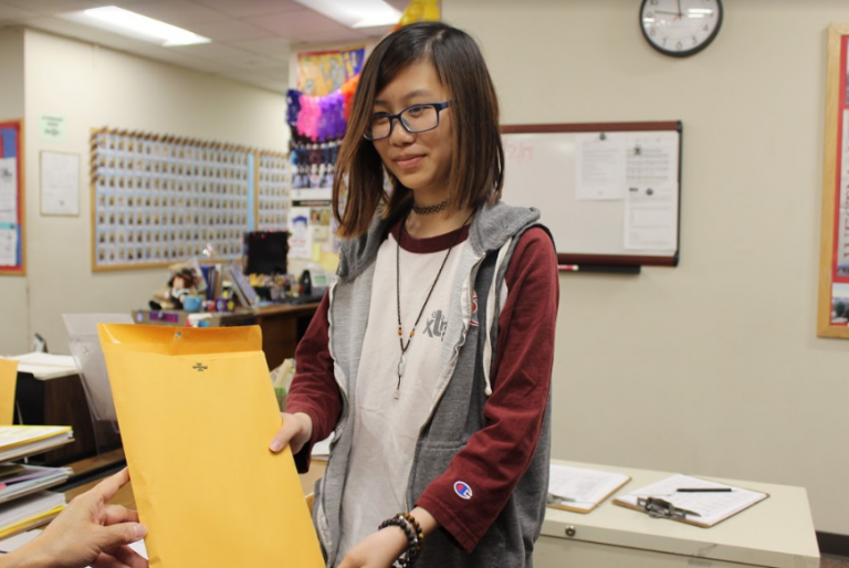 Lum helps school as student aide