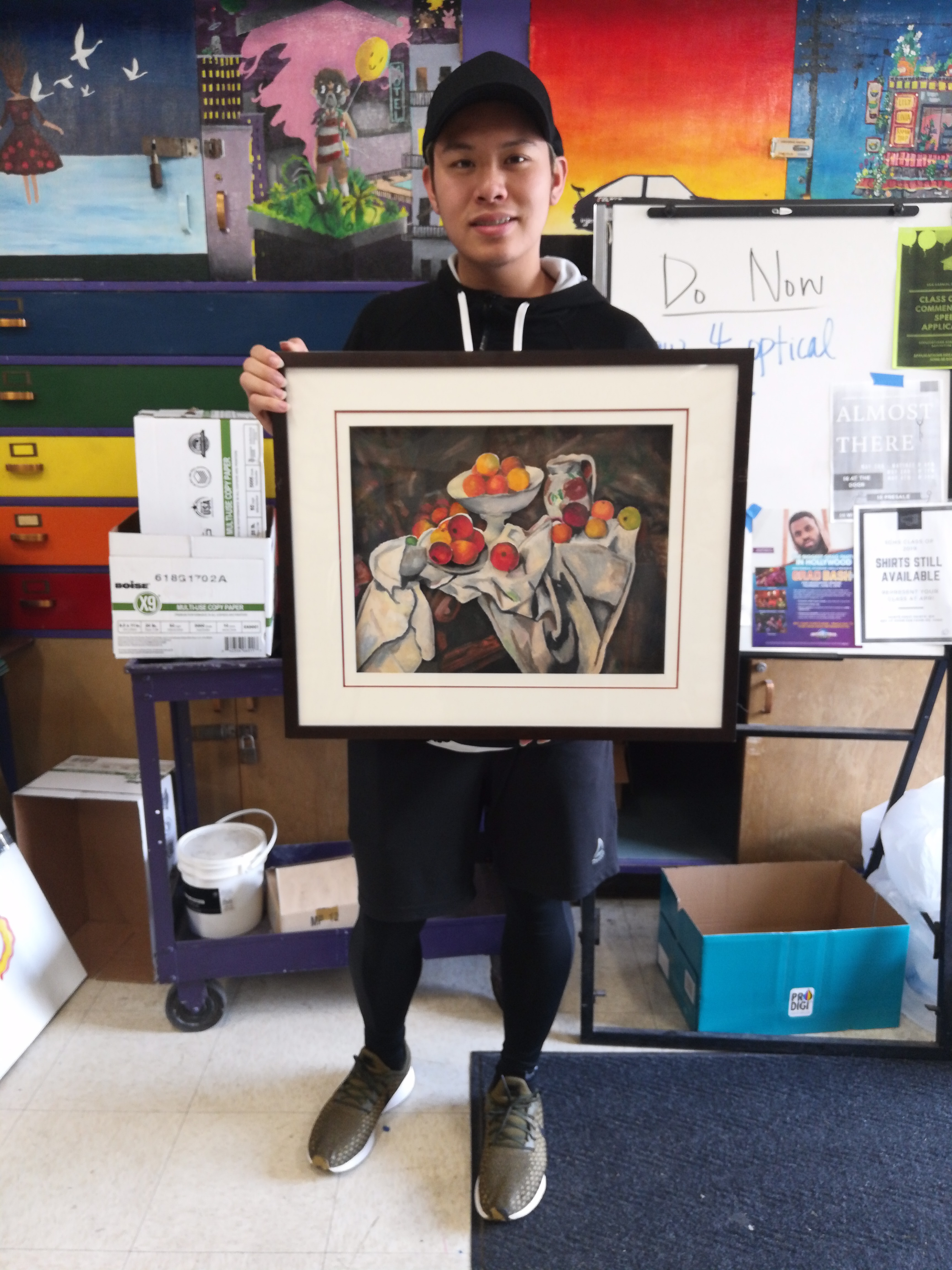 "Senior Tim Xu stands with his first place piece titled ""Oil Pastel Drawing of Fruits""."